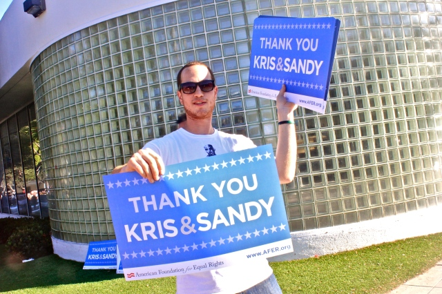Passing out Thank You Kris and Sandy posters on San Vincente and Santa Monica Blvd. for the rally.